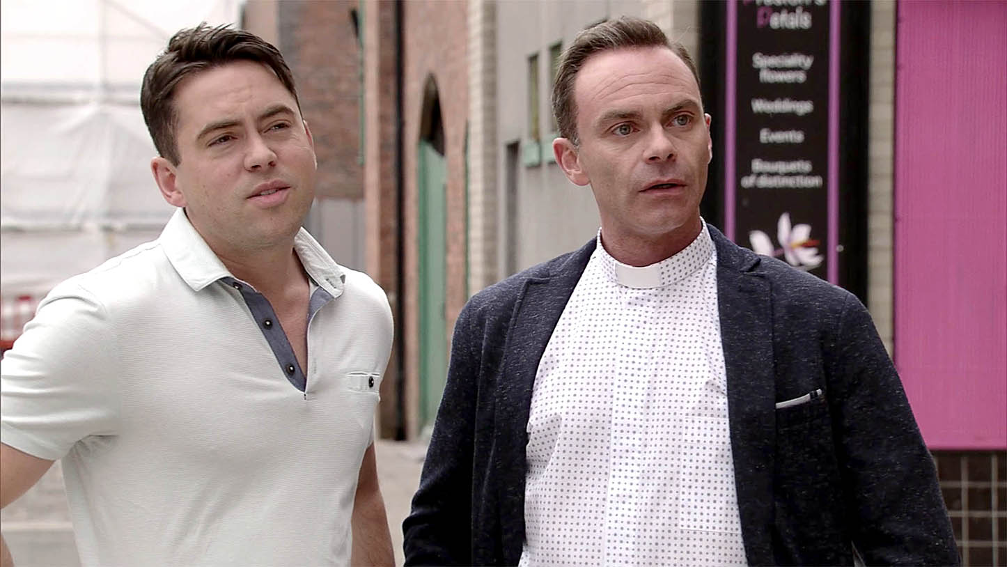 FROM ITV  STRICT EMBARGO - No Use Before Tuesday 19 July 2016  Coronation Street - 8956  Friday 29 July 2016 - 1st Ep  As Billy Mayhew [DANIEL BROCKLEBANK] and Todd Grimshaw [BRUNO LANGLEY] emerge from the community centre, Eileen Grimshaw [SUE CLEAVER] wants to know what they've been doing. Painting on his best innocent face, Todd explains he was just helping the vicar with playgroup. Eileen's suspicious.   Picture contact: david.crook@itv.com on 0161 952 6214  This photograph is (C) ITV Plc and can only be reproduced for editorial purposes directly in connection with the programme or event mentioned above, or ITV plc. Once made available by ITV plc Picture Desk, this photograph can be reproduced once only up until the transmission [TX] date and no reproduction fee will be charged. Any subsequent usage may incur a fee. This photograph must not be manipulated [excluding basic cropping] in a manner which alters the visual appearance of the person photographed deemed detrimental or inappropriate by ITV plc Picture Desk. This photograph must not be syndicated to any other company, publication or website, or permanently archived, without the express written permission of ITV Plc Picture Desk. Full Terms and conditions are available on the website www.itvpictures.com